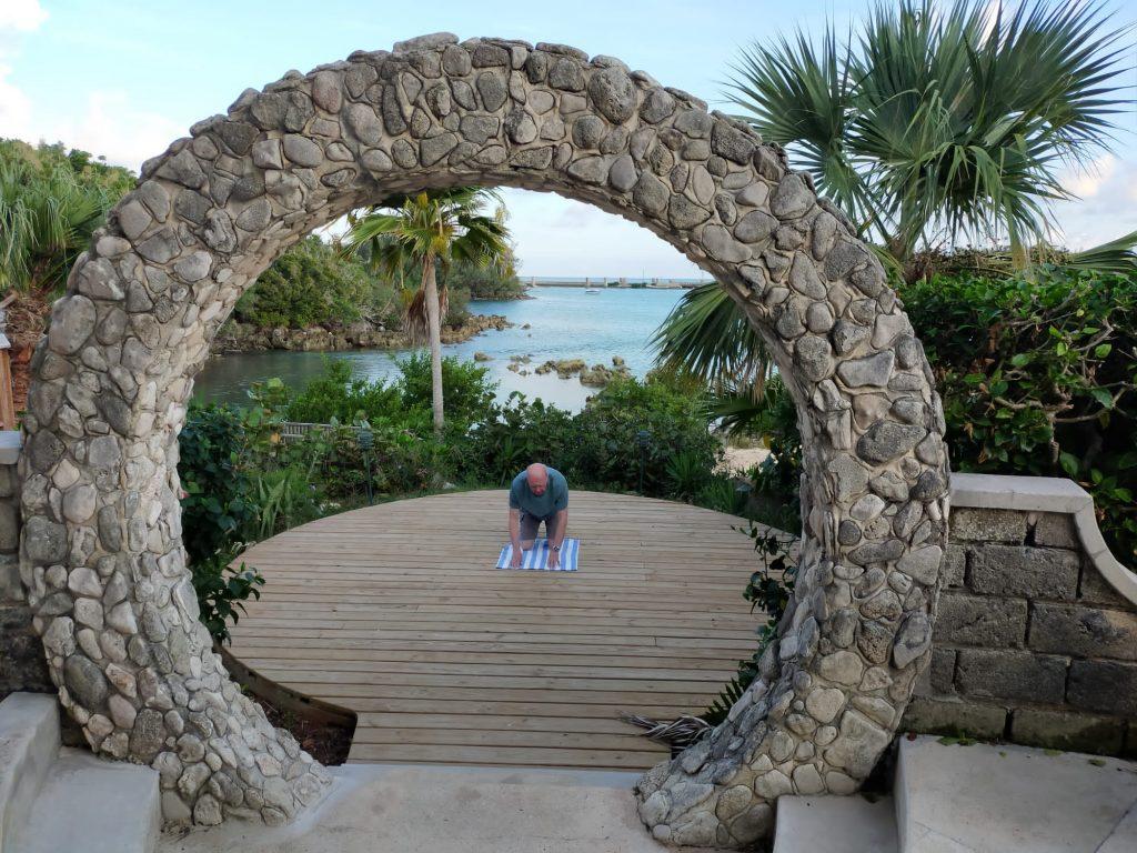 Yoga for Blokes in the Bahamas Pat doing Chakravakrasana colour pic Alan Dedman